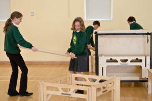 Two girls from Banwell Primary putting together a StackaStage portable wooden stage kit