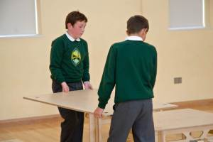 Two boys from Banwell Primary putting together a StackaStage portable wooden stage kit