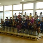 Children of Firs Farm Primary School playing music on a portable modular stage system for schools