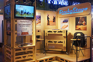 StackaStage Portable Wooden Stage System on display at an exhibition space